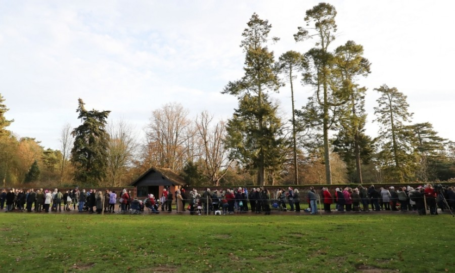 The public waited to catch a glimpse of the royal family arriving for the Christmas day service in Norfolk.