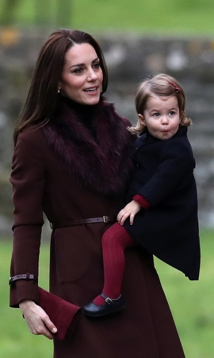 Pucker up! Charlotte's tights and bow matched perfectly with Kate's maroon coat. This was also her first church service.
