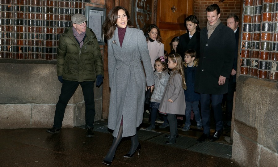 Crown Princess Mary looked chic in a grey coat as she stepped out with her family on Christmas Eve after attending mass at Aarhus Cathedral.