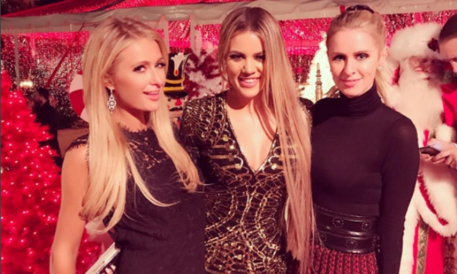 That's a hot Christmas! Khloe Kardashian, Paris and Nicky Hilton got in a fabulous photo during Kris Jenner's annual Christmas party.