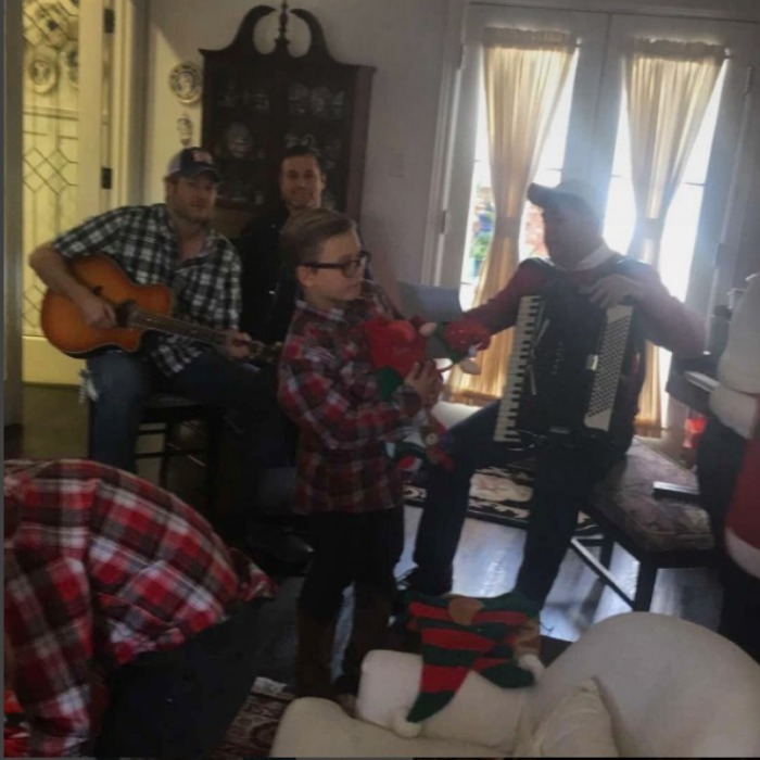 Gwen Stefani had all of her boys with her the holiday. The <i>Make You Like Me</i> star spent Christmas Eve singing along with boyfriend Blake Shelton and her three sons Kingston, Zuma and Apollo, who all wore flannel. 