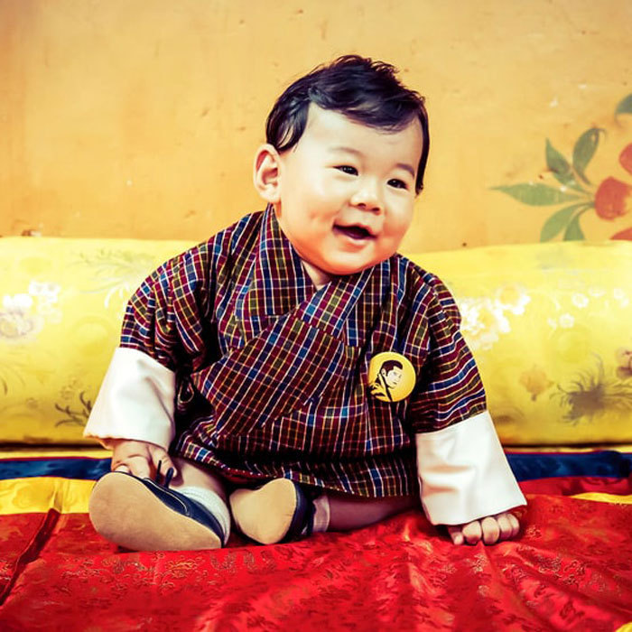 The Bhutan baby, Prince Jigme smiled bright for his six month photos and showed off his head full of black hair. 