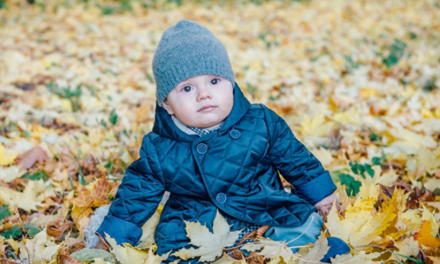 Prince Oscar brought all of the fall cuteness during the beginning of autumn. The little Prince posed for a photo, shared by his mom, bundled up in a blue coat and hat set.  