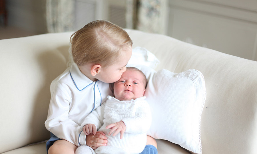 Proud brother George delicately kissed the head of his, then 1-month old sister. The adorable pictures were snapped by keen photographer and mom, Kate.