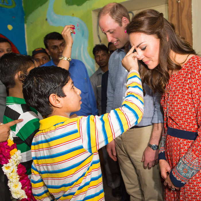 The royal couple was greeted with a tilak at the children's center run by the charity Salaam Baalak during their royal tour of India and Bhutan.