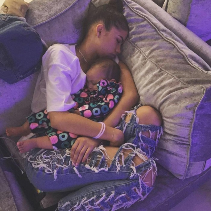 "Zendaya was #NYEgoals when she opted for a cozy night in. The actress posted a photo of her snuggled up on the couch with a small child, writing: ""While everyone else is turnin up....goodnight.""