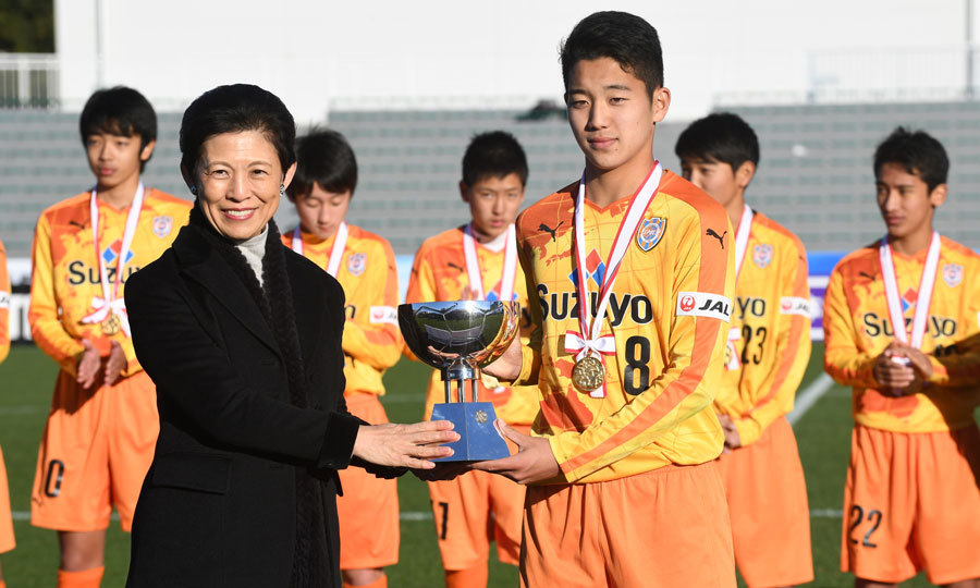 Princess Hisako Takamado of Japan posed with captain Riyo Kawamoto of the Shimizu S-Pulse soccer team after  the Prince Takamado Trophy All Japan Youth (U-15) Football Tournament final match in Tokyo.