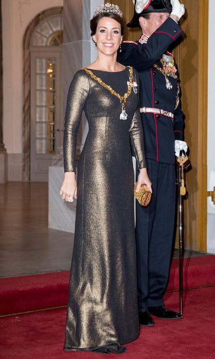 Princess Marie of Denmark turned heads wearing a figure-hugging, full-length gown to the Danish royal family's annual New Year's reception at Amalienborg Palace in Copenhagen.