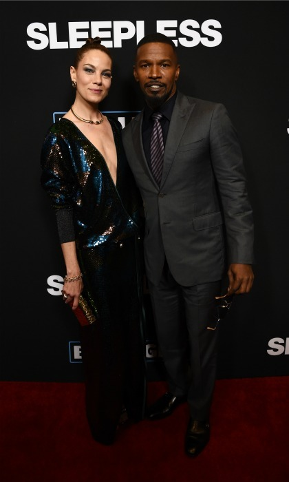 January 5: Michelle Monaghan stood next to co-star Jamie Foxx during the premiere of <i>Sleepless</i> in L.A. The actress took the plunge in a dress from the Vivienne Westwood 2017 couture collection, paired with gold Stella Luna heels, an Edie Parker clutch and vintage jewelry by  Cartier. 