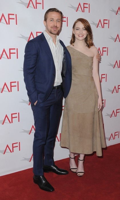January 6: Ryan Gosling and Emma Stone arrived at the 17th Annual AFI Awards luncheon at the Four Seasons Hotel in Beverly Hills. The co-stars looked ready to support their acclaimed film, <i>La La Land</i>, with Emma wearing a very unique suede dress by The Row.