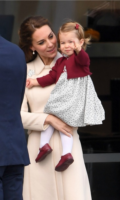 Kate held on to her little lady as they prepared to make their grand exit from Canada during their royal tour of the country in 2016.