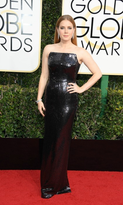 <i>Nocturnal Animals</i> star Amy Adams was on trend donning a sparkling black gown by Tom Ford for the 74th annual Golden Globes. 