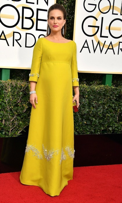 Natalie Portman's pregnancy glow added some additional sunshine to her custom embellished Prada dress during the 74th annual Golden Globes. 