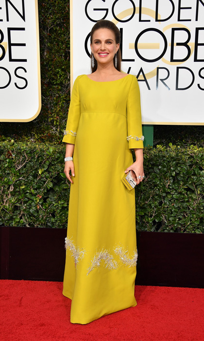<i>Jackie</i> actress Natalie Portman channeled her inner Jackie O dressing her baby bump up in an embellished Prada dress for the 2017 Golden Globes.