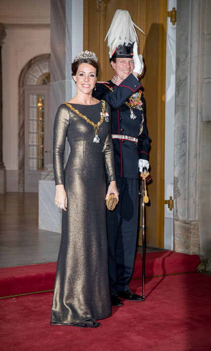 Princess Marie of Denmark turned heads wearing a metallic full-length gown to the annual New Year reception held at Amalienborg Palace with her husband Prince Joachim.