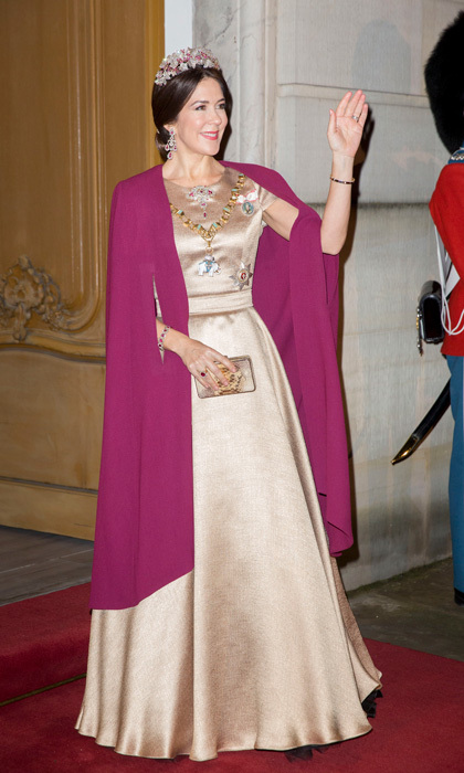 Crown Princess Mary of Denmark dazzled wearing a gold ballgown and jewels to the New Year's Levee at Amalienborg palace.