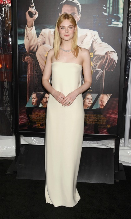 January 9: Elle Fanning looked effortlessly elegant wearing a cream gown by Oscar de la Renta to the Hollywood premiere of <i>Live by Night</i>. 