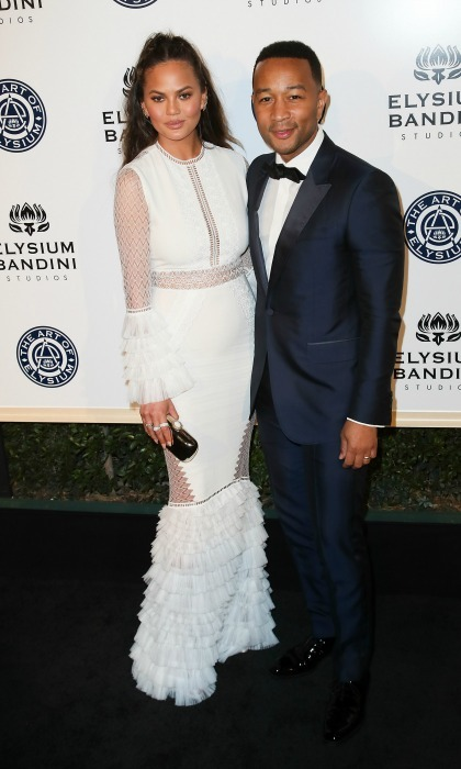 January 7: Chrissy Teigen showed a little skin in an all-white custom dress by Jonathan Simkhai beside husband John Legend at the tenth annual Art of Elysium presents Stevie Wonder's HEAVEN celebrating the charity's 20th anniversary at Red Studios event in L.A. 