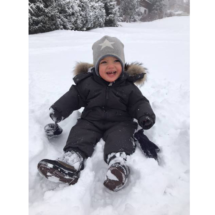 Nicolas was bundled up as he played in the snow during a family ski holiday in Switzerland over the holidays.