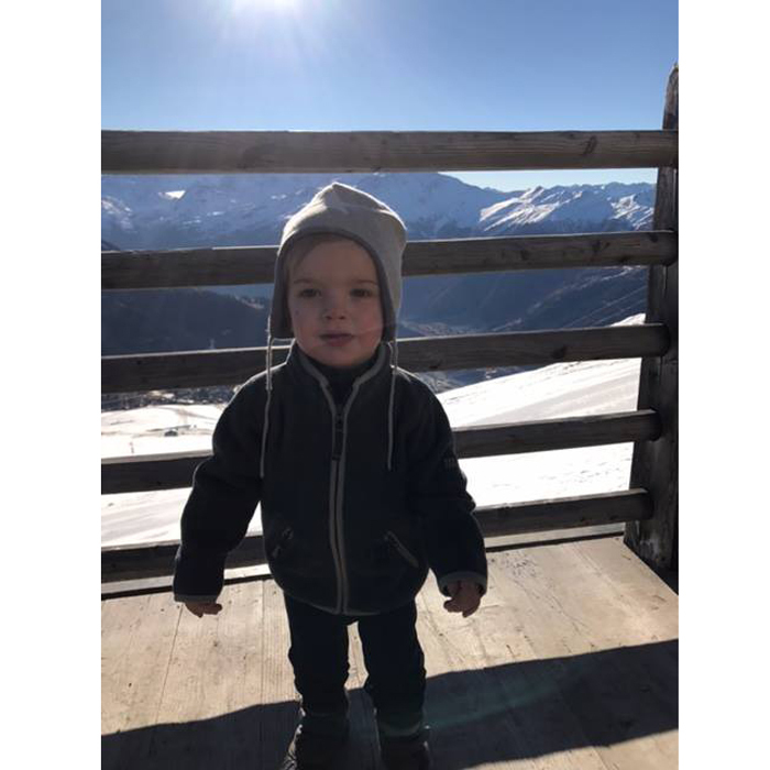 The young Prince posed on a balcony in front of a scenic view of the Swiss Alps.