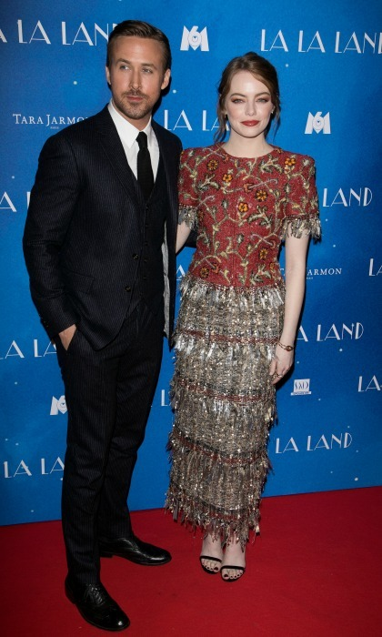 January 10: Ryan Gosling looked handsome in a classic black suit as he stood next to <i>La La Land</i> co-star Emma Stone, who wore a tweed Chanel ensemble during the film's premiere in Paris. 