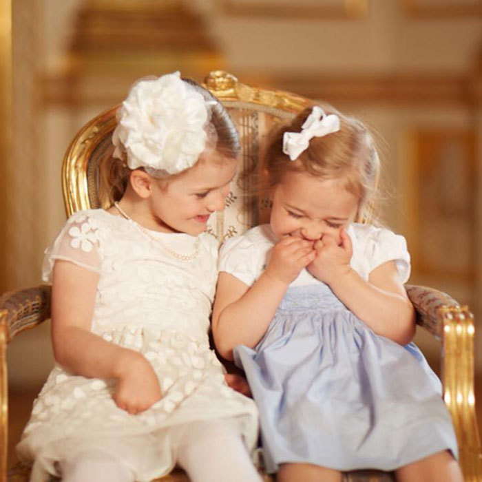 The adorable cousin duo shared a laugh during Prince Oscar's christening.