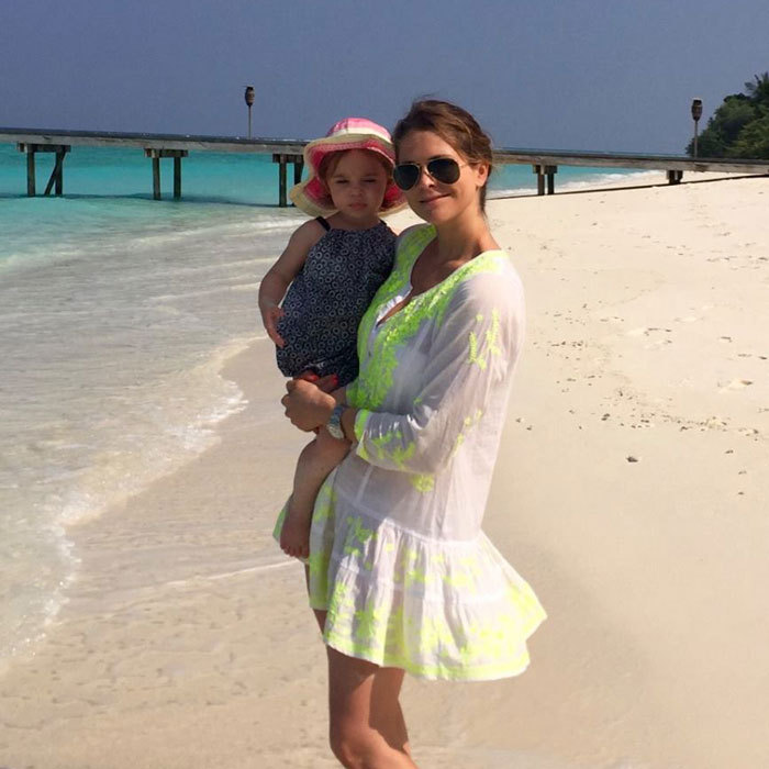 "Princess Madeleine of Sweden enjoyed ""family time"" with her little beach babe during a tropical getaway.