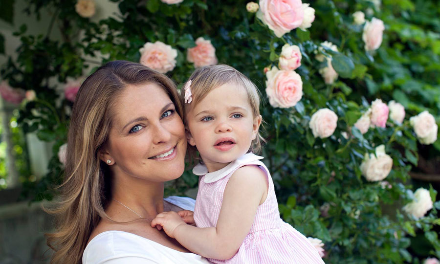 Madeleine and her little girl made a beautiful mother-daughter duo posing next to a rose bush.