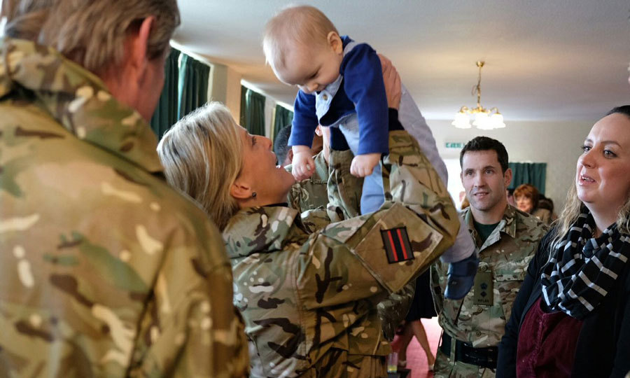 Sophie Wessex, who is a Royal Colonel of the 5th Battalion The Rifles, played with a baby during her visit to the Ward Barracks, Bulford.