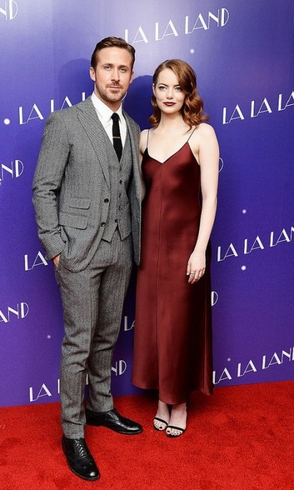 January 12: Emma Stone matched her darker hair shade to her bordeaux satin slip dress by The Row during the London screening of <i>La La Land</i>. The actress was joined by co-star Ryan Gosling, who was dashing in his 3-piece suit by Thom Sweeney.