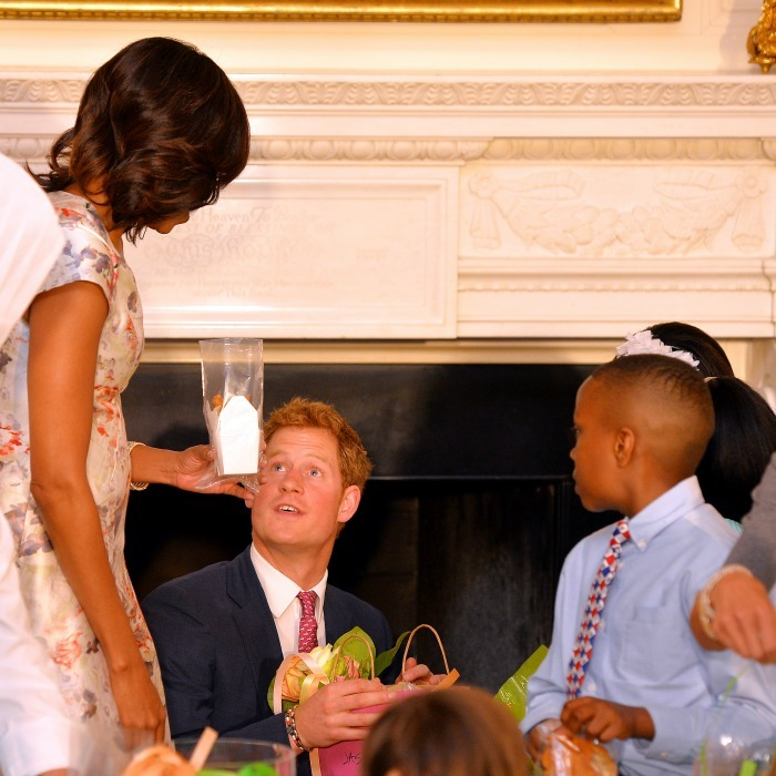 Prince Harry and Michelle sat with children who were making presents for their mothers during an event honoring military families. 