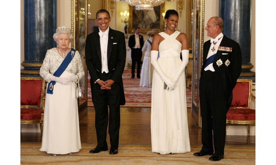 Queen Elizabeth and President Obama were photo ready while Michelle and Philip were caught in a candid moment during the State Banquet at Buckingham Palace.