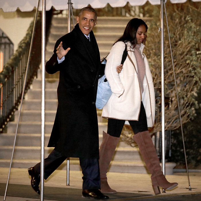 December 2016: Sasha kept warm in thigh-high brown boots and a white fleece coat as she and her father left the White House for a trip to Hawaii.