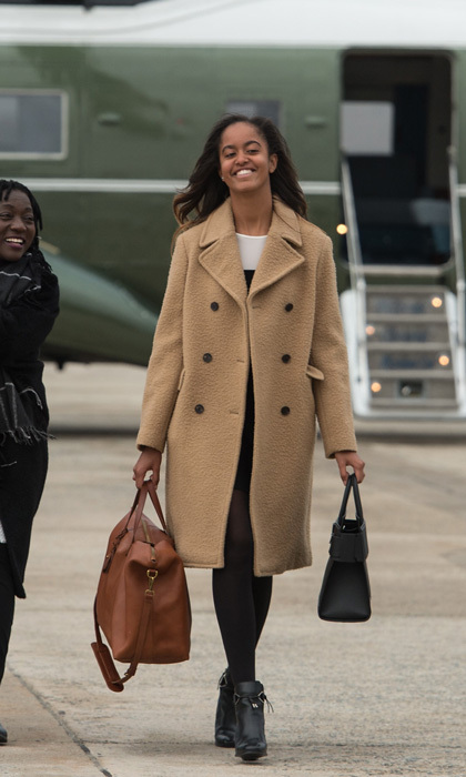 January 2017: Malia kept it casual in earth tones as she boarded Air Force One at Andrews Air Force Base to depart for Chicago for her father's farewell address.