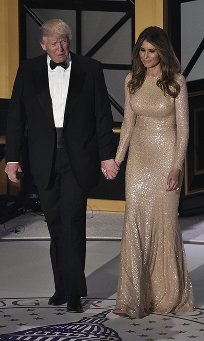 The President-elect made his entrance at the celebratory black tie gala hand in hand with wife Melania. 