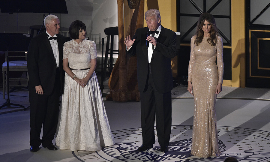 The Trumps were joined by VP-elect Mike Pence and his wife Karen, who wore a white lace cap-sleeved gown.