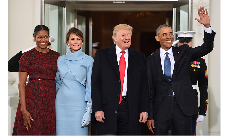 Melania exuded elegance donning a pale blue ensemble by American designer Ralph Lauren. Michelle opted for a red frock that featured a black waist detail.