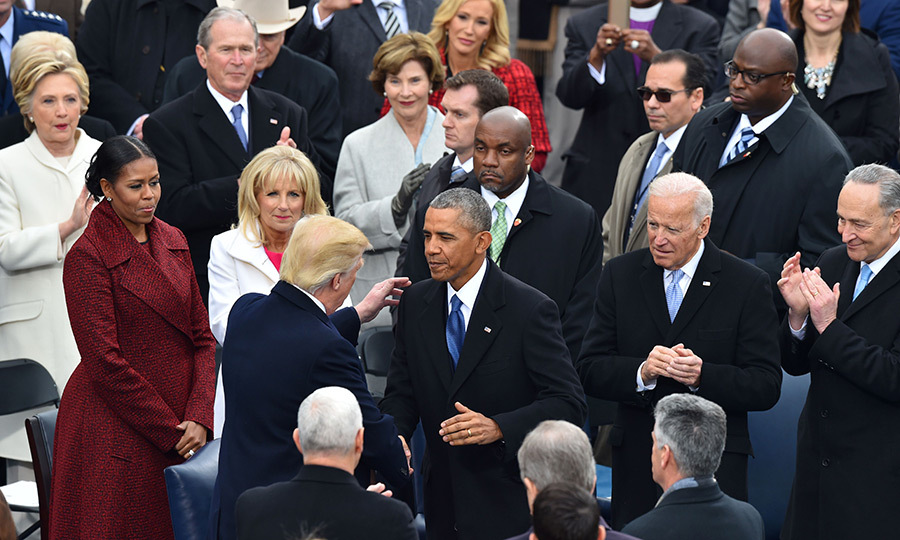 As ex-presidents and first ladies looked on, Donald Trump exchanged greetings with former President Obama.