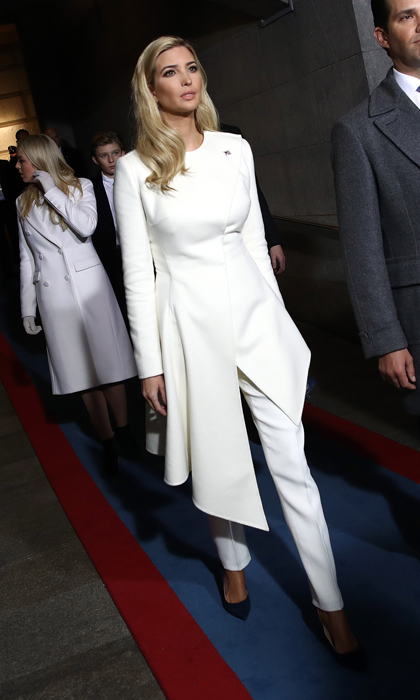 Jared Kushner's wife Ivanka was the picture of elegance wearing a chic winter white ensemble by <B>Oscar de la Renta</B> for the presidential inauguration of her father Donald Trump.