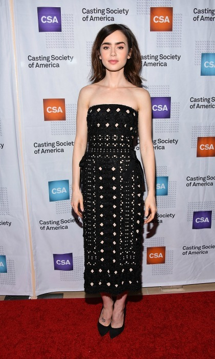 January 19: No sleeves, no problem! Lily Collins wore a strapless black dress during the 2017 Annual Artios Awards in Beverly Hills. 