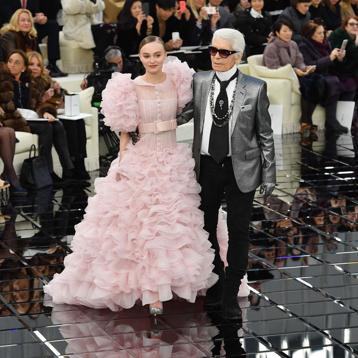 Lily-Rose Depp looked pretty in pink modeling a frothy tiered dress at the Chanel Spring Summer 2017 haute couture presentation.