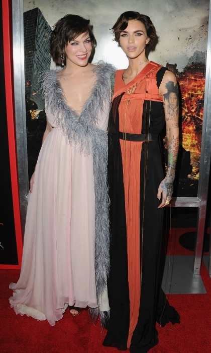 January 23: Good vs. evil! Milla Jovovich and Ruby Rose had contrasting style during the <i>Resident Evil: The Final chapter</i> premiere in L.A. Ruby stunned in an orange and black dress by Vionne, while Milla wore a pale pink and grey gown. 