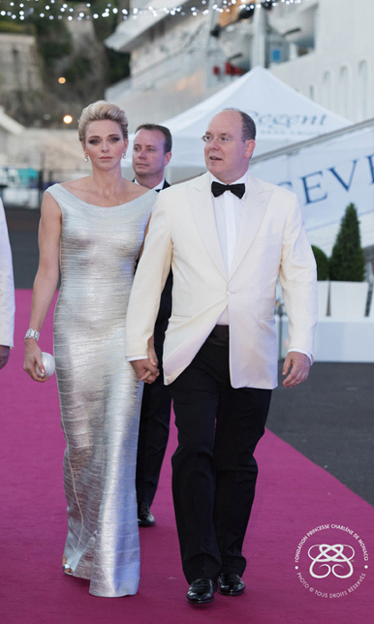July 2016: Princess Charlene dazzled in a silver gown alongside her husband Prince Albert as sge christen the Seven Seas Explorer cruise ship.