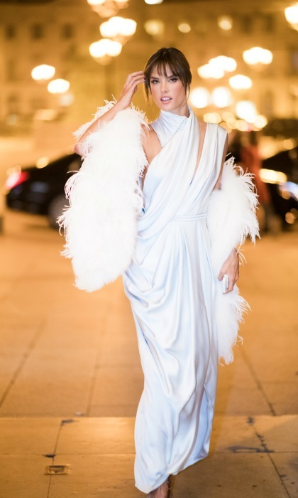 Alessandra Ambrosio turned the streets of Paris into her runway in an all white ensemble. 