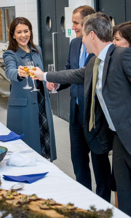 Cheers! Crown Princess Mary clinked glasses with her husband Crown Prince Frederik during a cooking workshop at a hospitality school on day two of the Icelandic state visit in Copenhagen, Denmark. 