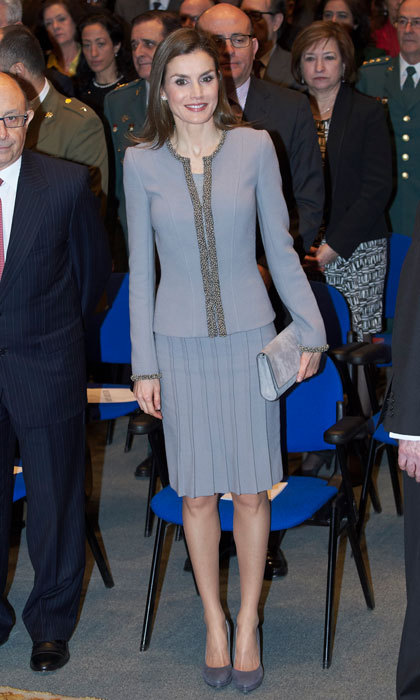 Queen Letizia was <i>fifty shades of grey</i> and chic wearing a pleated knee-length skirt and collarless jacket by Felipe Varela to the Tomas Francisco Prieto Awards held at the Casa de La Moneda Museum.