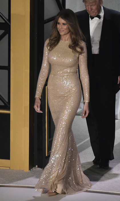 The brunette beauty glistened in a gold gown by Reem Acra at a candlelight dinner held the night before Donald Trump's presidential inauguration.