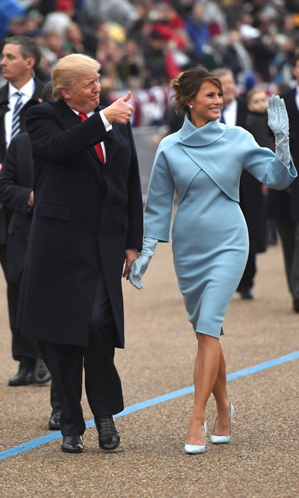 The first lady exuded elegance on Inauguration Day wearing a Ralph Lauren doubleface jacket that featured a collar cutaway, which she paired with a matching mock-turtle dress.