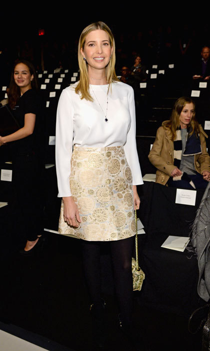 The always-stylish business mogul attended the 2014 Carolina Herrera fall fashion show in NYC wearing a white blouse and gold brocade skirt.  