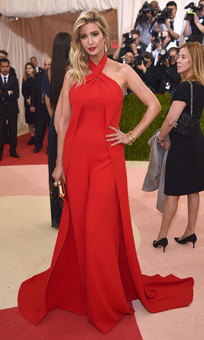 "President Trump's daughter was the lady in red wearing a Ralph Lauren Collection custom red silk crepe jumpsuit to the 2016 ""Manus x Machina: Fashion In An Age Of Technology"" Costume Institute Gala at the Metropolitan Museum of Art.